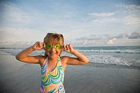 Girl wearing goggles at beach, Florida, United States