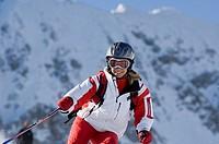 Austria, Salzburger Land, Altenmarkt_ Zauchensee, Young woman skiing