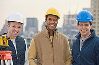 Multi_ethnic male construction workers wearing hard hats