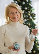 Senior woman holding Christmas ornaments