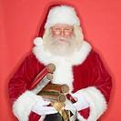 Santa Claus holding wrapping paper and ribbon