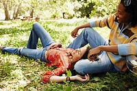 Multi_ethnic couple relaxing outdoors