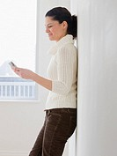 Hispanic woman looking at electronic organizer