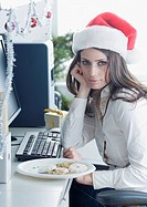 Businesswoman wearing Santa Claus hat