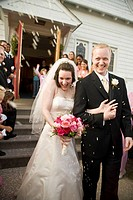 Wedding guests throwing rice at newlyweds, Fredrick, Maryland
