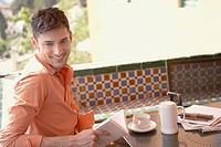 Man enjoying espresso in outdoor cafe