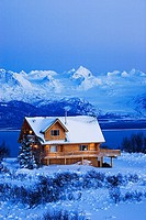 Sunset on a Log home that overlooks Kachemak Bay above Homer on the Kenai Peninsula in Southcentral, Alaska