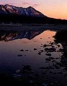 Alpenglow Light on Chugach Mountains reflecting in pool of Matanuska River Southcentral Alaska Spring