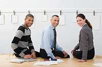 Colleagues sitting on table