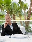 A businesswoman thinking