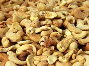 Pile of roasted cashew nuts _ background