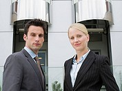 Portrait of two businesspeople outside a hotel