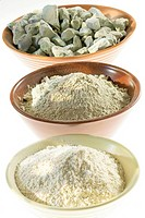 Pieces and powder of green sand and white clay.