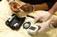 TEST FOR DIABETES Photo essay from hospital. Department of diabetology endocrinology at Saint Louis Hospital in Paris. Glycemia test. The nurse compar...