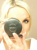 WOMAN PUTTING ON MAKE_UP Worldwide distribution except for South Africa