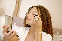 WOMAN PUTTING ON MAKE_UP Model.