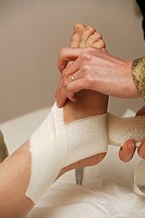 Photo essay from doctor´s office in Fismes, France. Bandage on an ankle sprain.