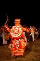 Dancer performing classical Theyam ritual dance , Kudali , Kerala , India