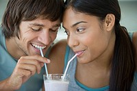Couple sharing a smoothie