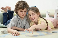 Brother and sister playing memory card game