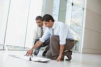 Financial advisors working on the floor