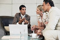 Financial advisor meeting with clients