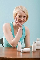 Young woman with milk drinks