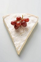 Piece of Brie with red grapes