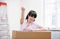 portrait of teenage girl in new home holding keys