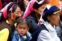 China, Sichuan, near Danba, Tibetan village festival, woman and young girl