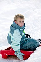 Young boy in a sledge