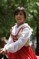 Young woman riding a horse wearing a traditional costume at the Cavalcata Sarda parade in Sassari, Sardinia, Italy, Europe