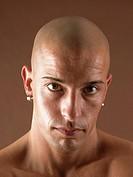 Bald-headed man, face, serious