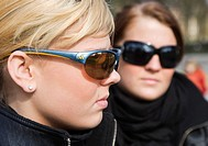Two teenagers, 15 years old, posing with sun glasses, Berlin, Germany, Europe