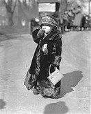 Child wearing a fur coat, smoking a cigarette, historic picture from about 1920
