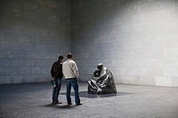 Interior room of the Neue Wache, two men viewing a sculpture by Kaethe Kollwitz, Berlin-Mitte, Germany, Europe
