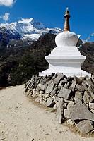 Buddhist stupa in front of Mt. Kongde Ri (6187 m), Bhote Koshi Valley, Sagarmatha National Park, UNESCO World Heritage Site, Khumbu Himal, Himalayas, ...