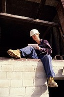 Female construction worker at a building site