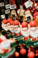 Santa Claus figurines for sale at Christmas decoration shop, Quebec City. Quebec, Canada