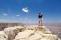 Man at abyss, Rim Trail, South Rim, Grand Canyon National Park, Arizona, USA