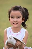 Chinese Girl Holding Pigeon,Beijing,China