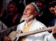 Musician at Hotan Sunday market, Xinjiang, China