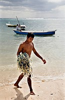 Man carrying fishing nets on beach, Lembongan, Bali, Indonesia