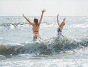 Girls jumping in the sea