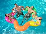 Friends relaxing in pool