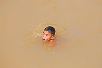 Boy swimming, Cambodia, Southeast Asia