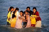 CHEERFUL GIRLS BATHING, MARINA BEACH, CHENNAI MADRAS, TAMIL NADU, INDIA
