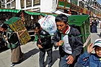 Tibetian with heavy load on the Barkor (walk around the Jokhang temple) , Nam-Tsho-Lake, Tibet