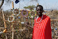 Masai woman sells colourful jewelry in the kraal Ngorongoro Conservation Area Tanzania