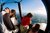 A couple, mother and child enjoying a ride in a hot air balloon, Balloon ride, Upper Bavaria, Germany